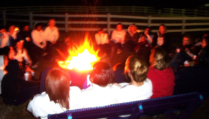residential students sitting around a bonfire