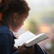 girl studying Bible